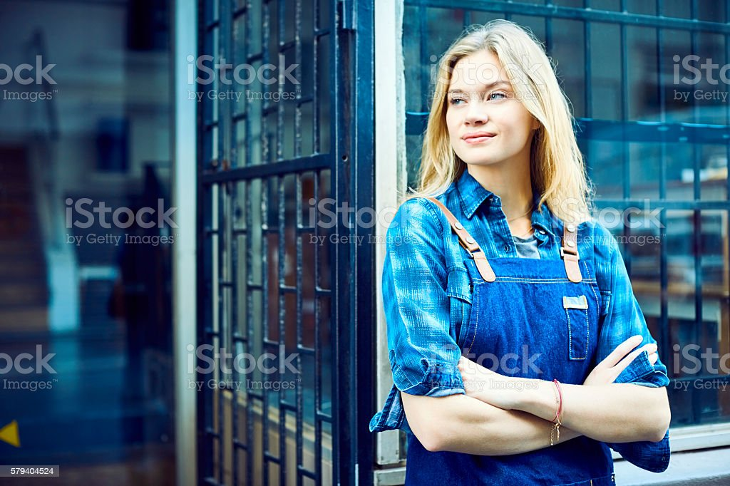 Confident Barista with arms crossed looking away stock photo