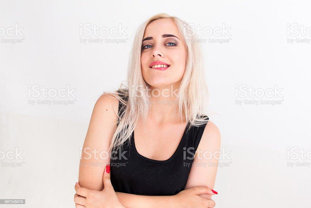 Confident beautiful woman biting her lip stock photo