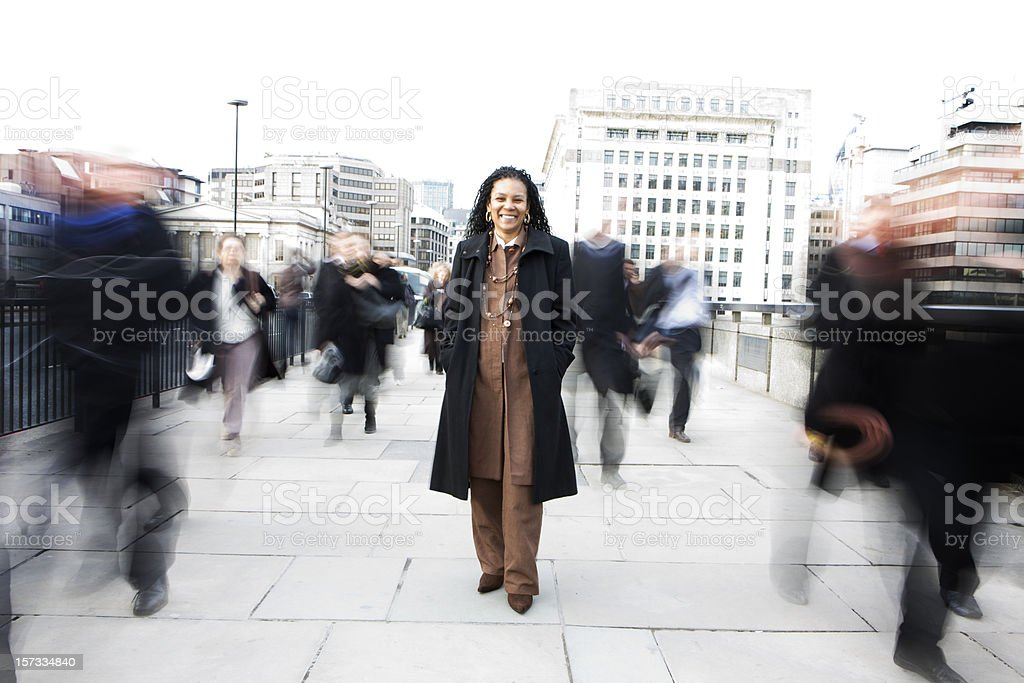 Confident Black-British business woman among the London commuter crowds stock photo
