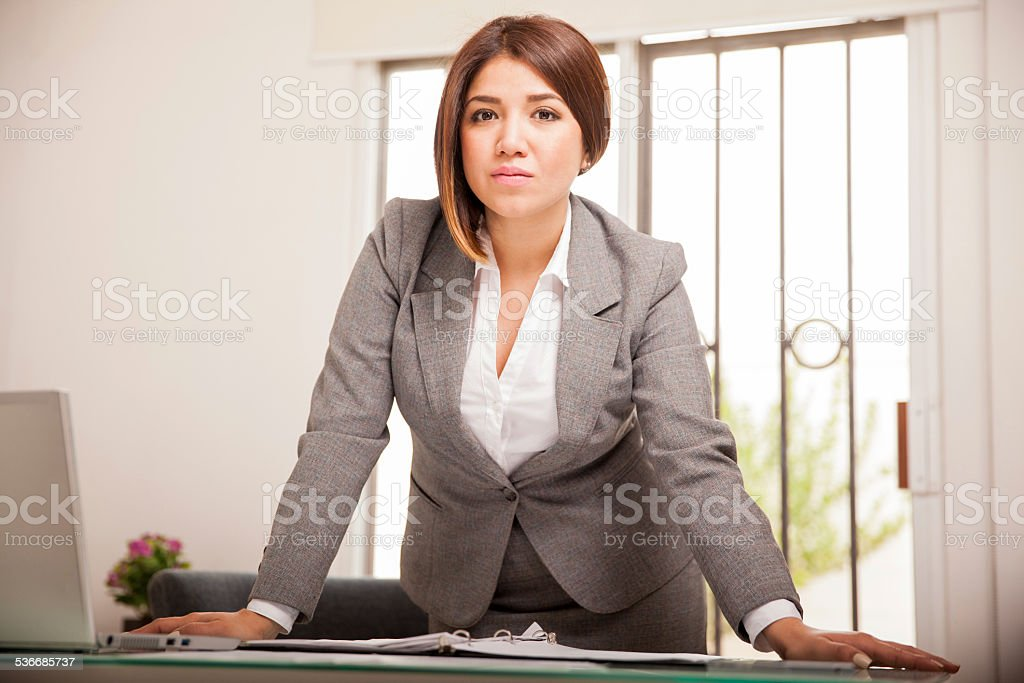 Confident boss at her office stock photo
