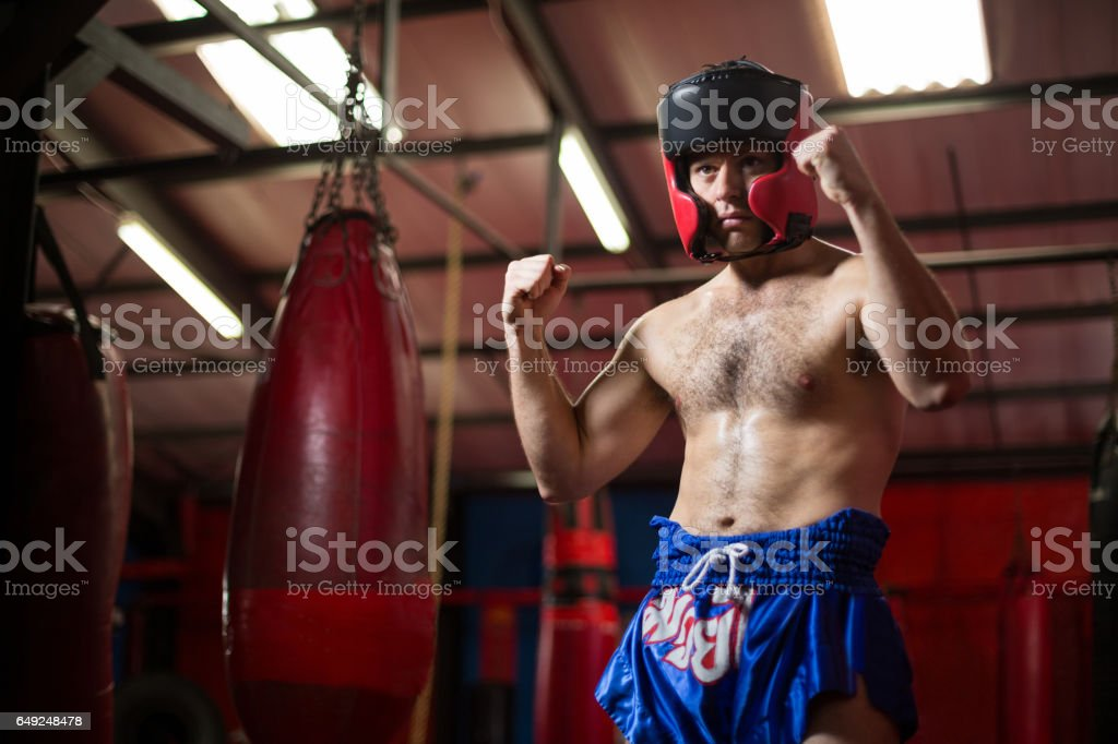 Confident boxer performing boxing stance stock photo