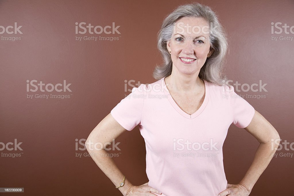 Confident Breast Cancer Survivor with Hands on Her Hips royalty-free stock photo