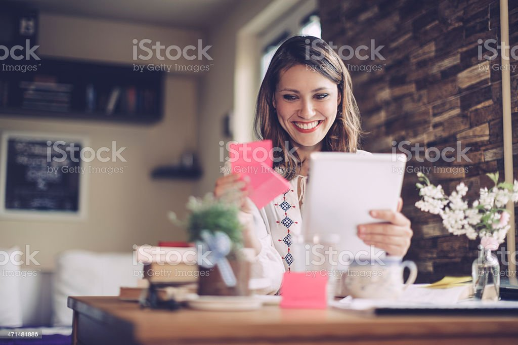 Confident, brunette businesswoman working at home stock photo