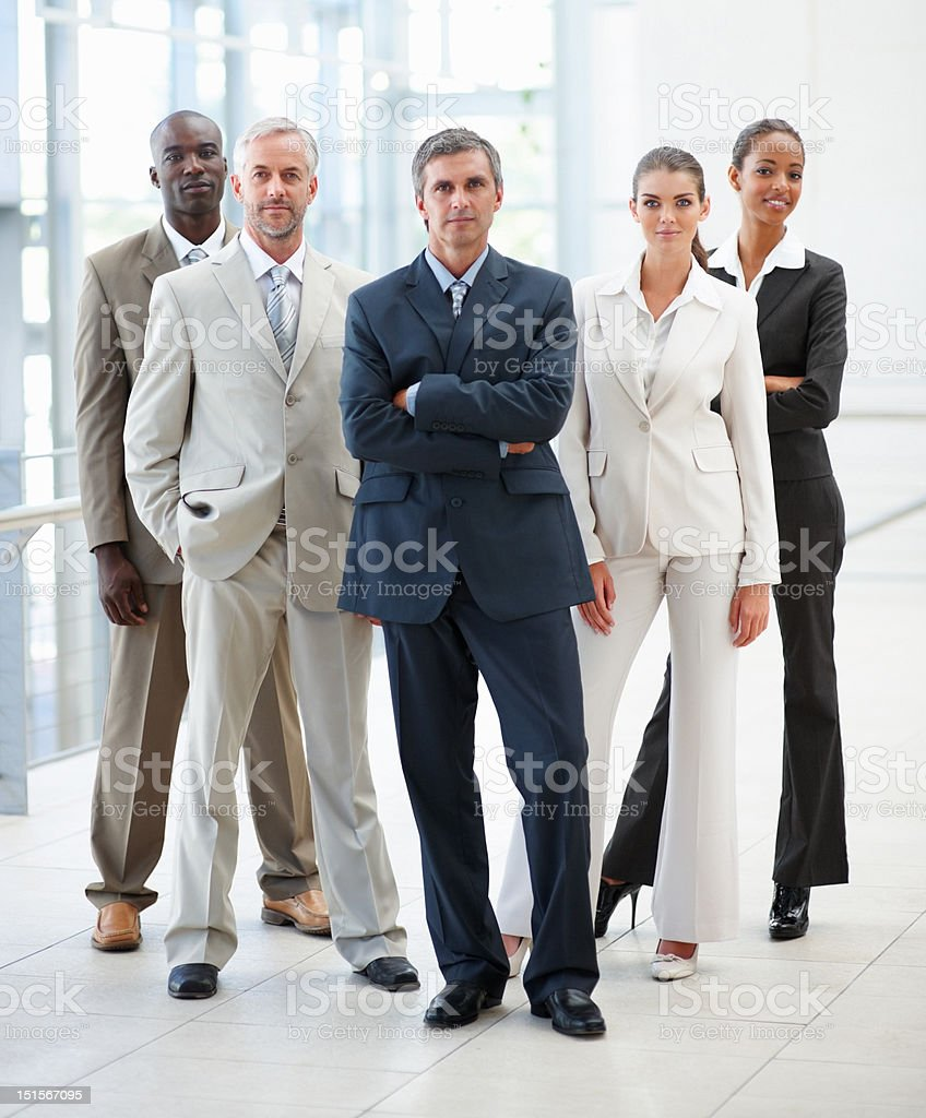 Confident business colleagues standing together stock photo