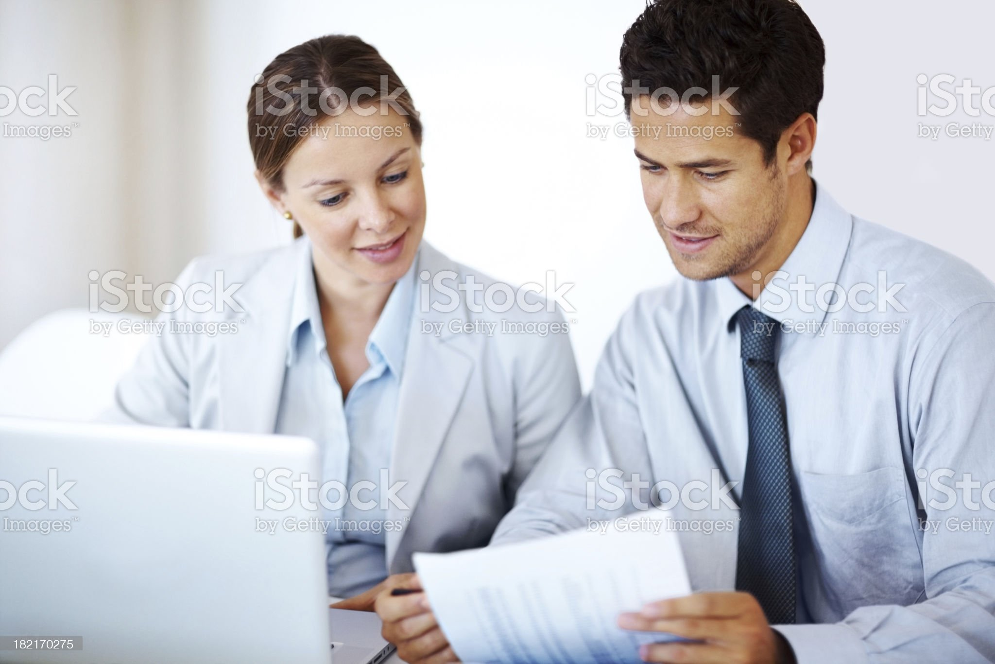 Confident business colleagues working together at office desk royalty-free stock photo