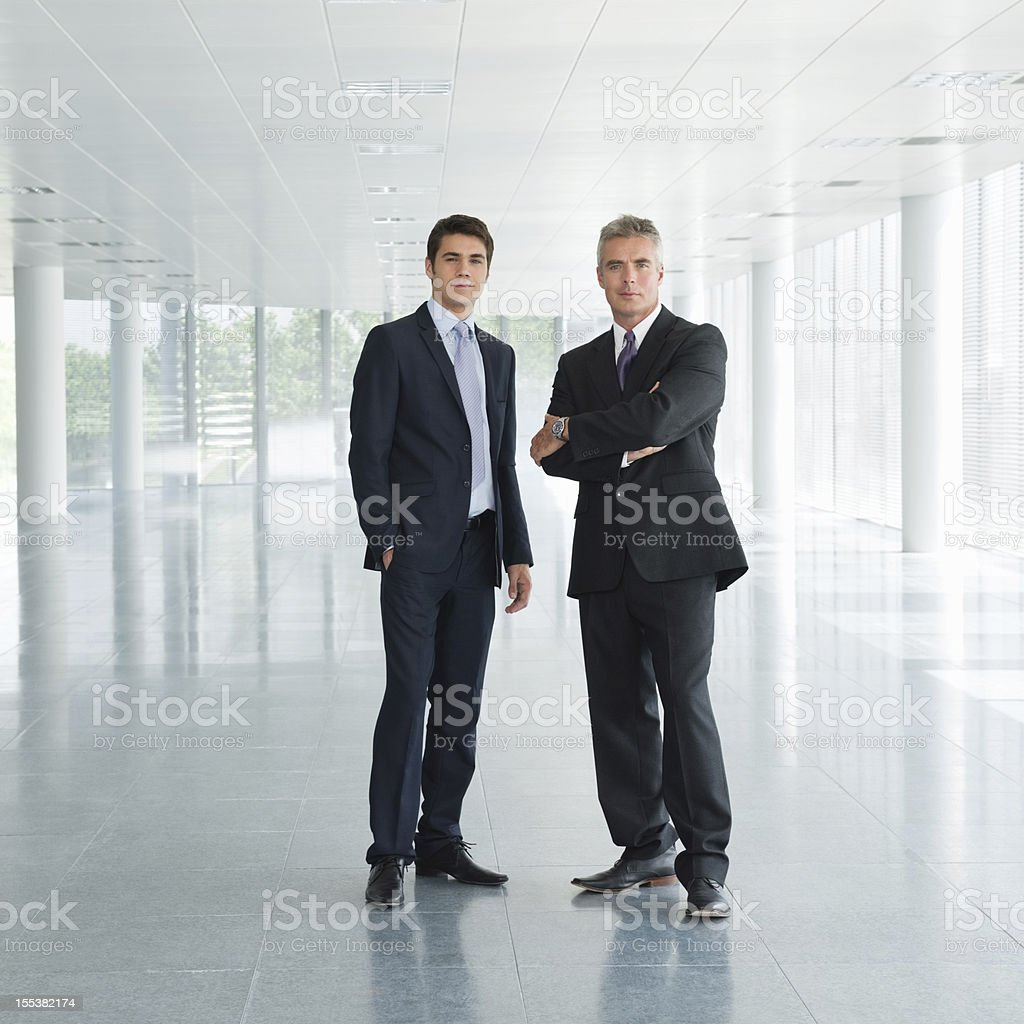 Confident Business Executives In Office Lobby stock photo