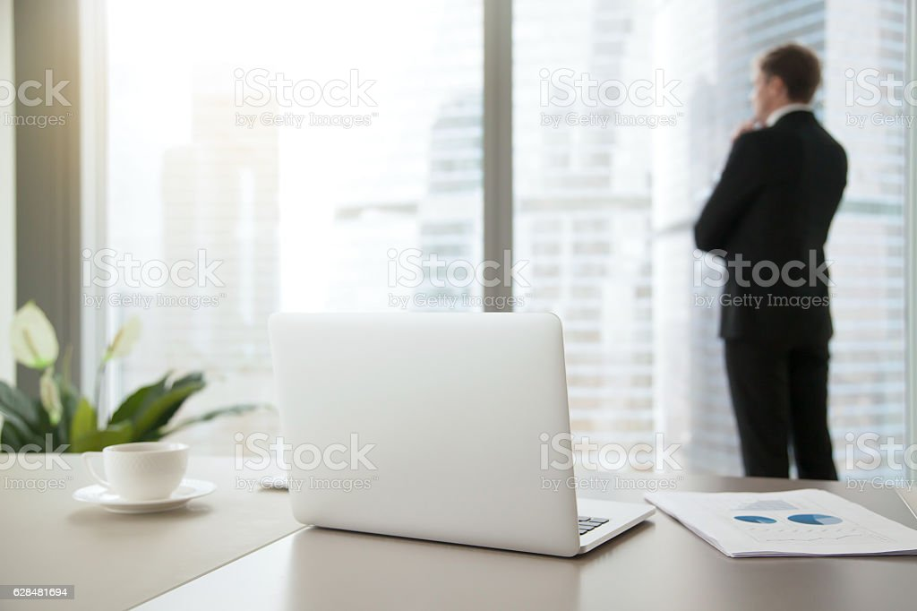 Confident business man contemplating in his office stock photo