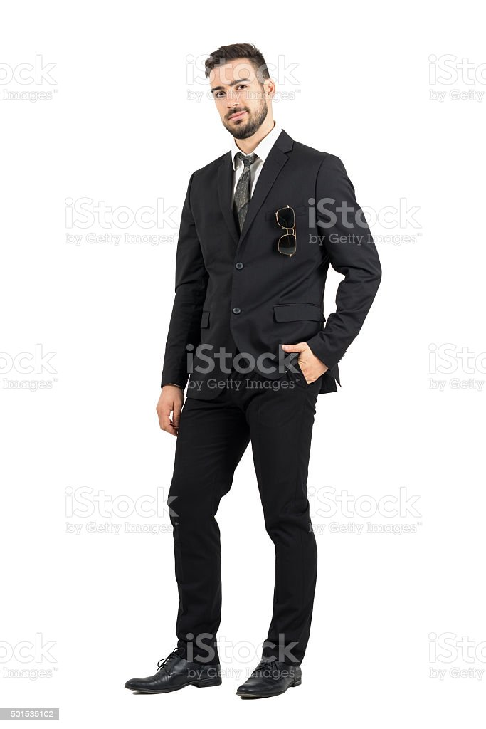 Confident business man in suit with sunglasses in pocket stock photo