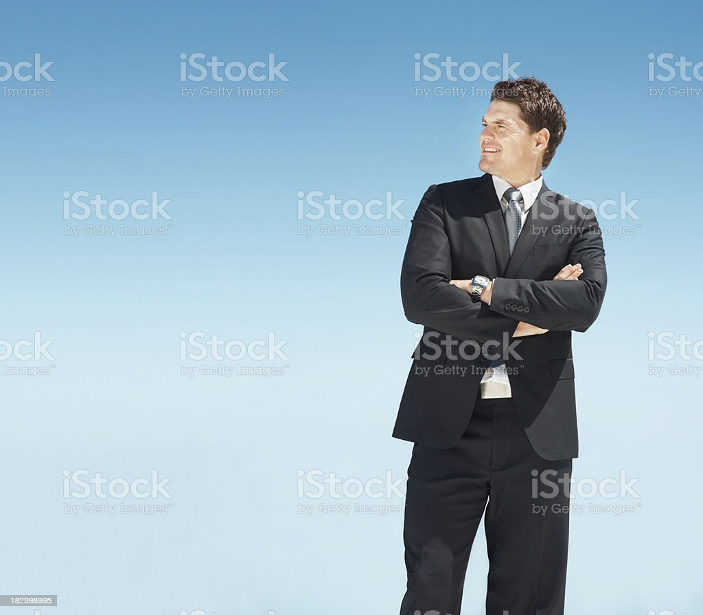 Confident business man looking towards copyspace royalty-free stock photo