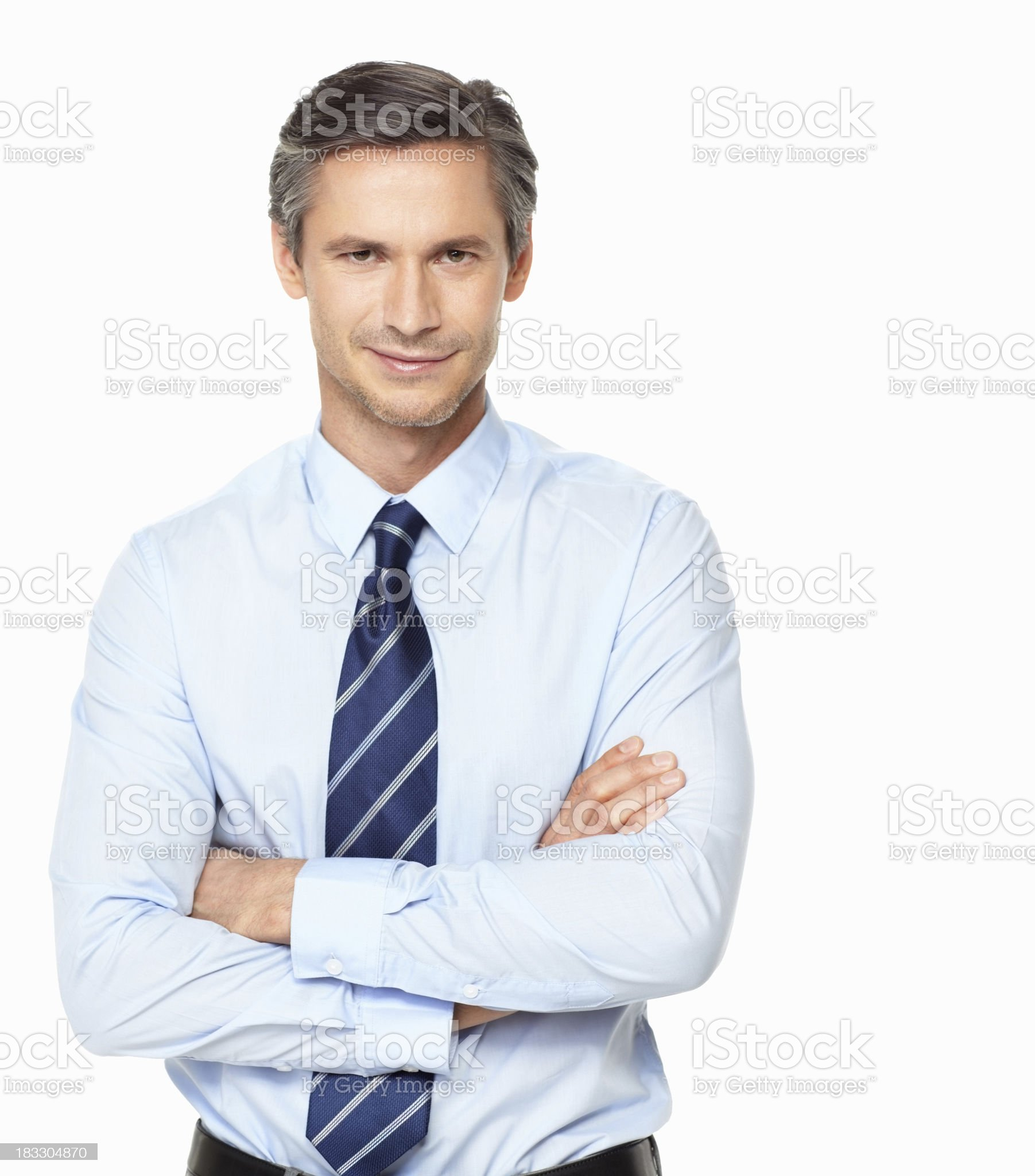 Confident business man with hands folded against white background royalty-free stock photo