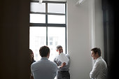 Confident business people in meeting at office