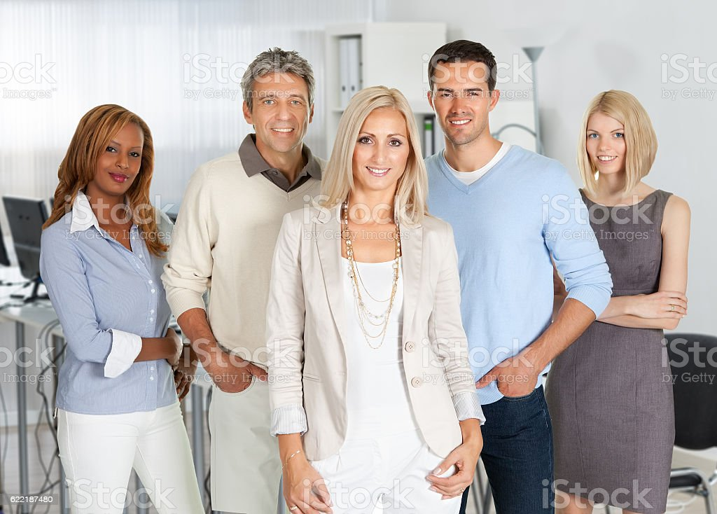Confident Business People Smiling In Office stock photo