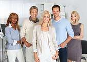 Confident Business People Smiling In Office