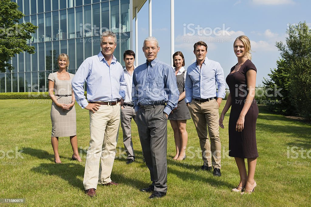 Confident Business People Standing At Lawn royalty-free stock photo