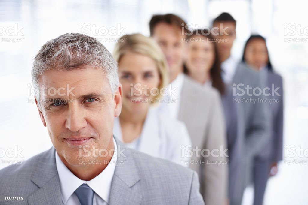 Confident business team in a row royalty-free stock photo