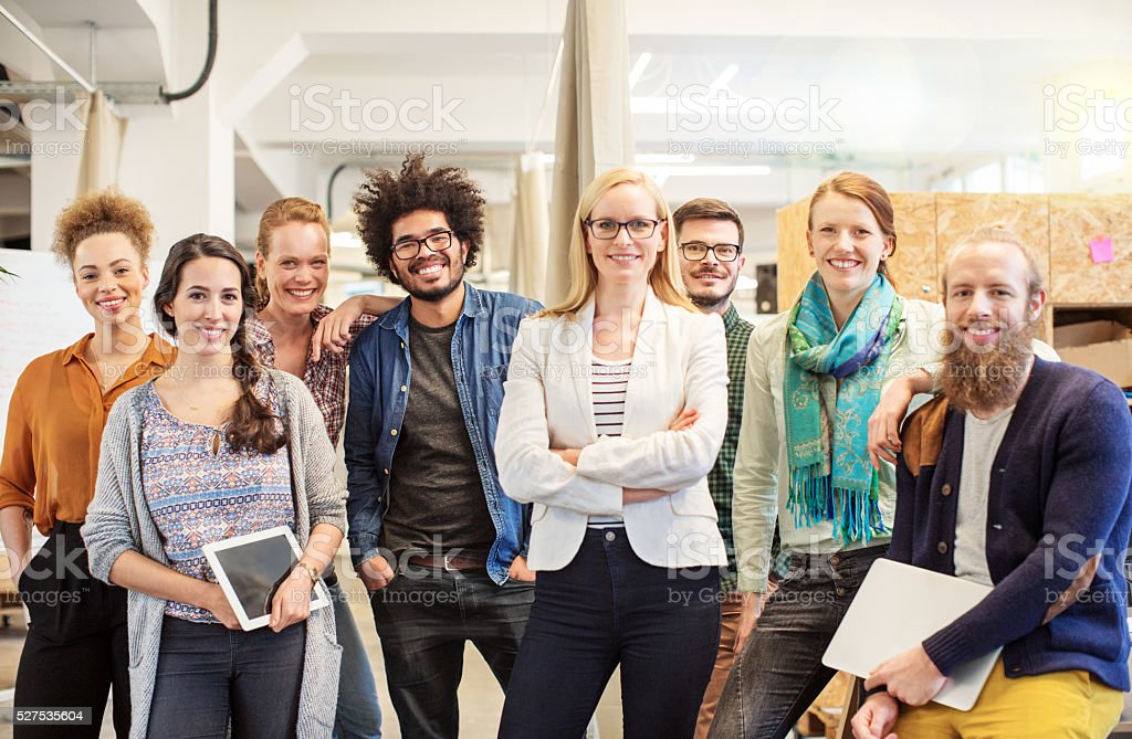 Confident business team smiling in office stock photo