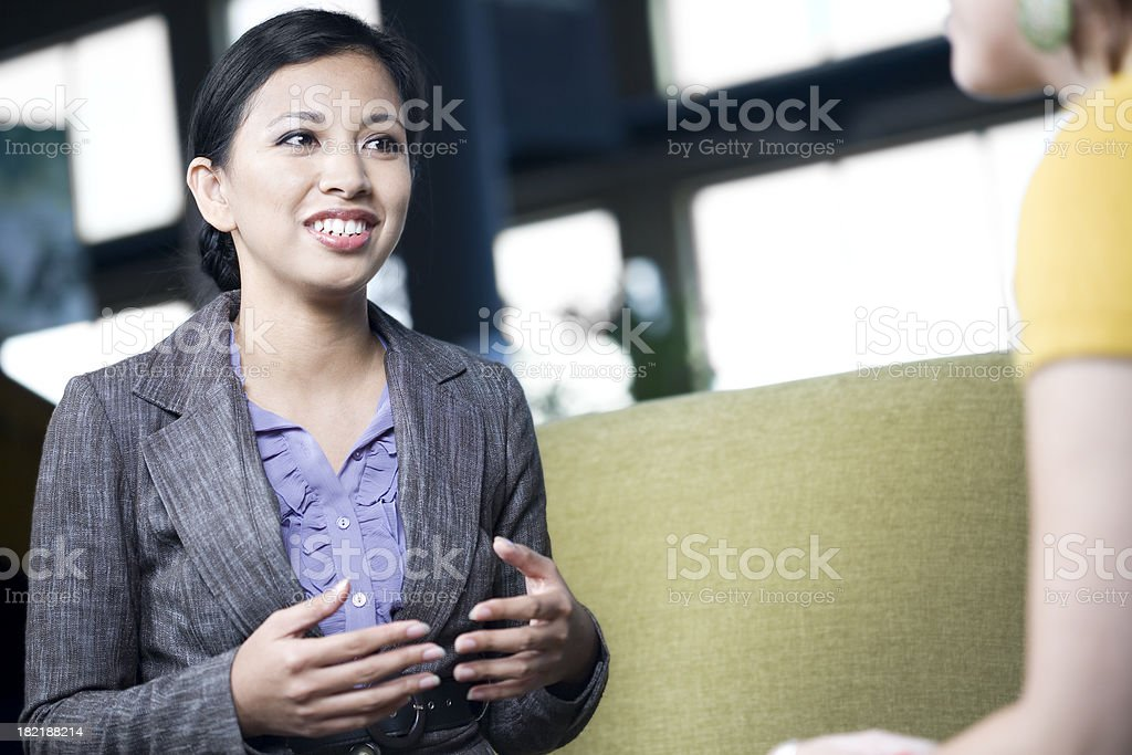 Confident Business Woman Explaining Something to Co-Worker royalty-free stock photo