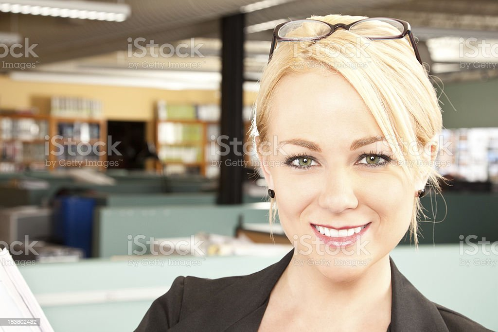 Confident Business Woman Holding Plans in Her Office royalty-free stock photo