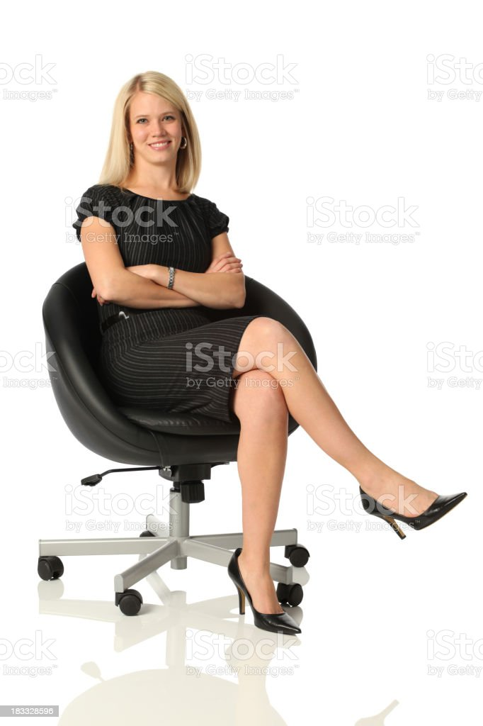 Confident business woman sitting in office chair stock photo