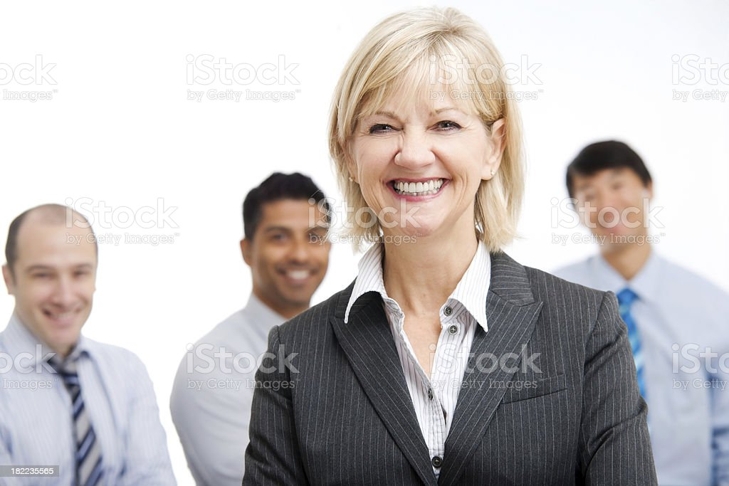 Confident Business Woman Standing with Team royalty-free stock photo