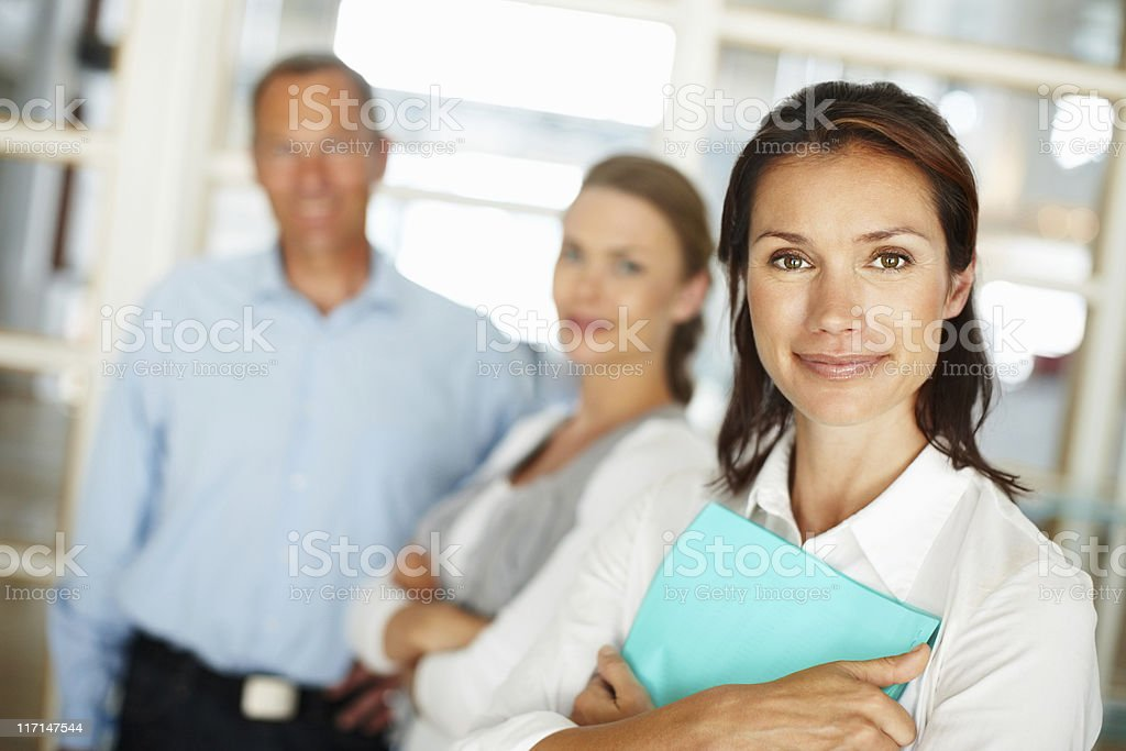 Confident business woman with colleagues in the background royalty-free stock photo