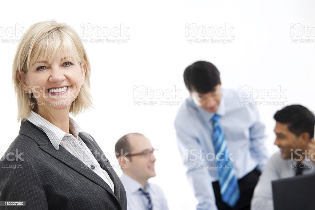 Confident Business Woman with Team in Background royalty-free stock photo