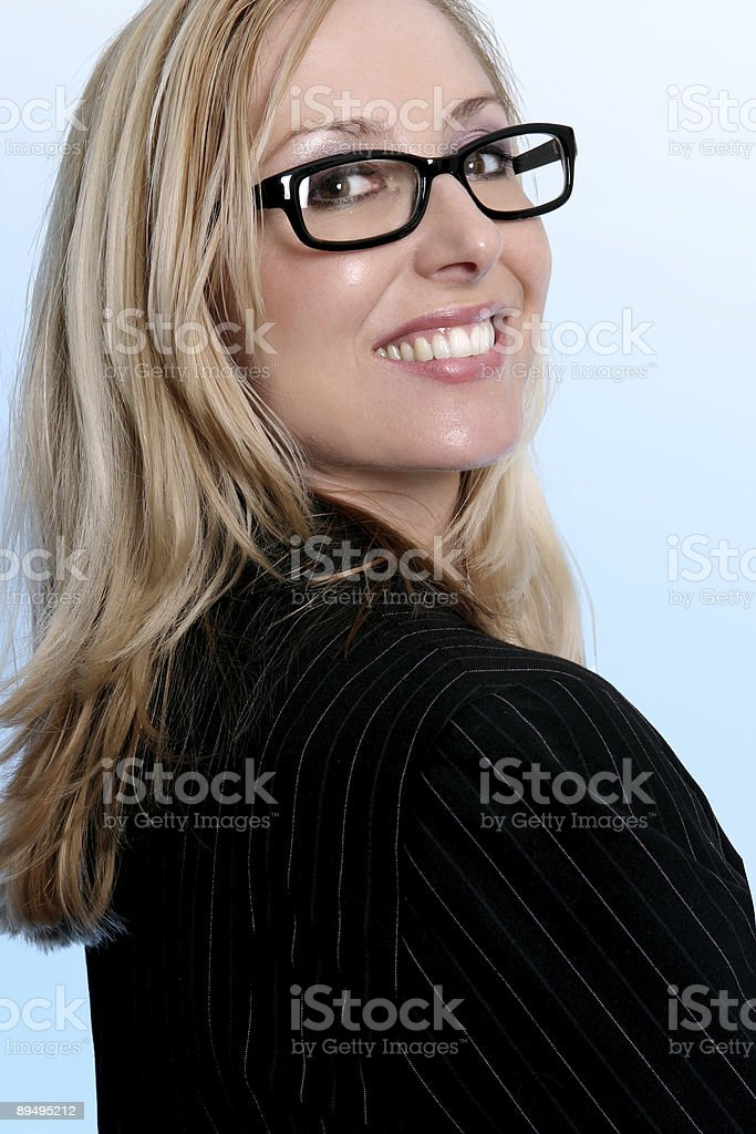 Confident business worker looking over shoulder and smiling royalty-free stock photo
