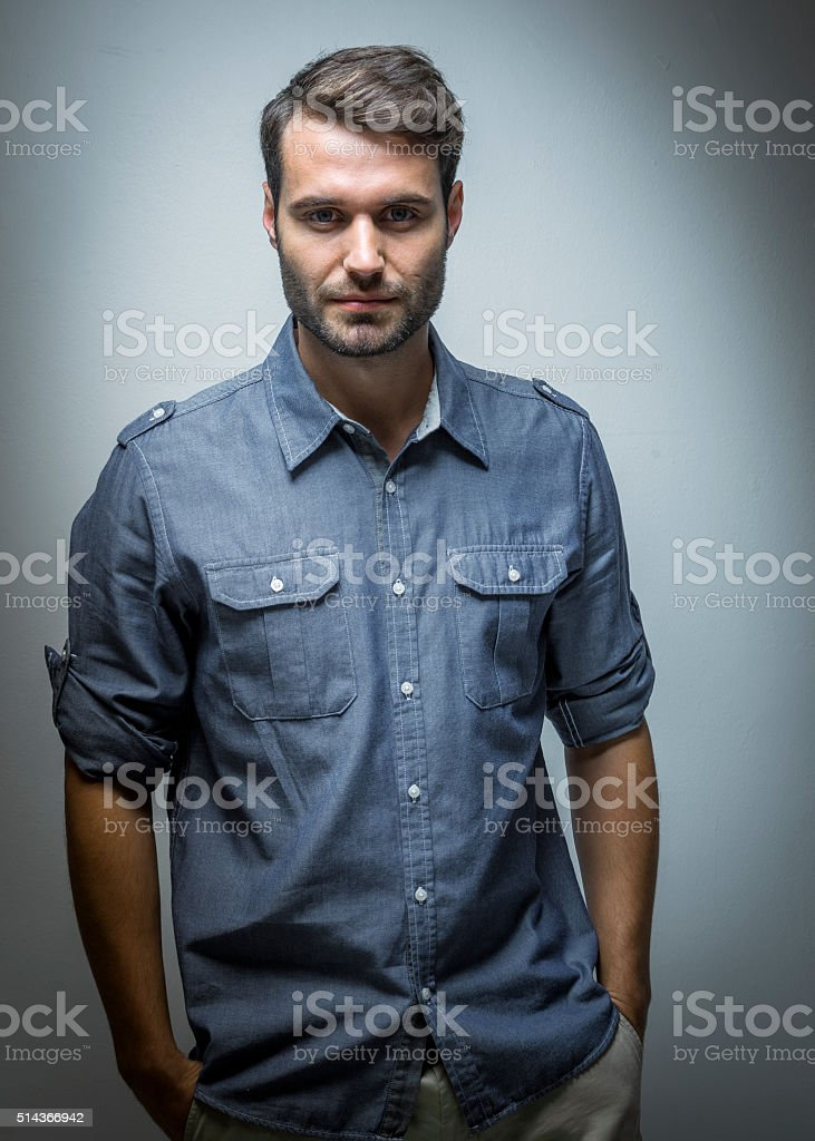 Confident businessman against grey background stock photo
