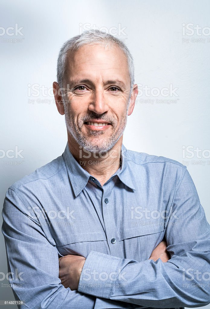 Confident businessman against white background stock photo