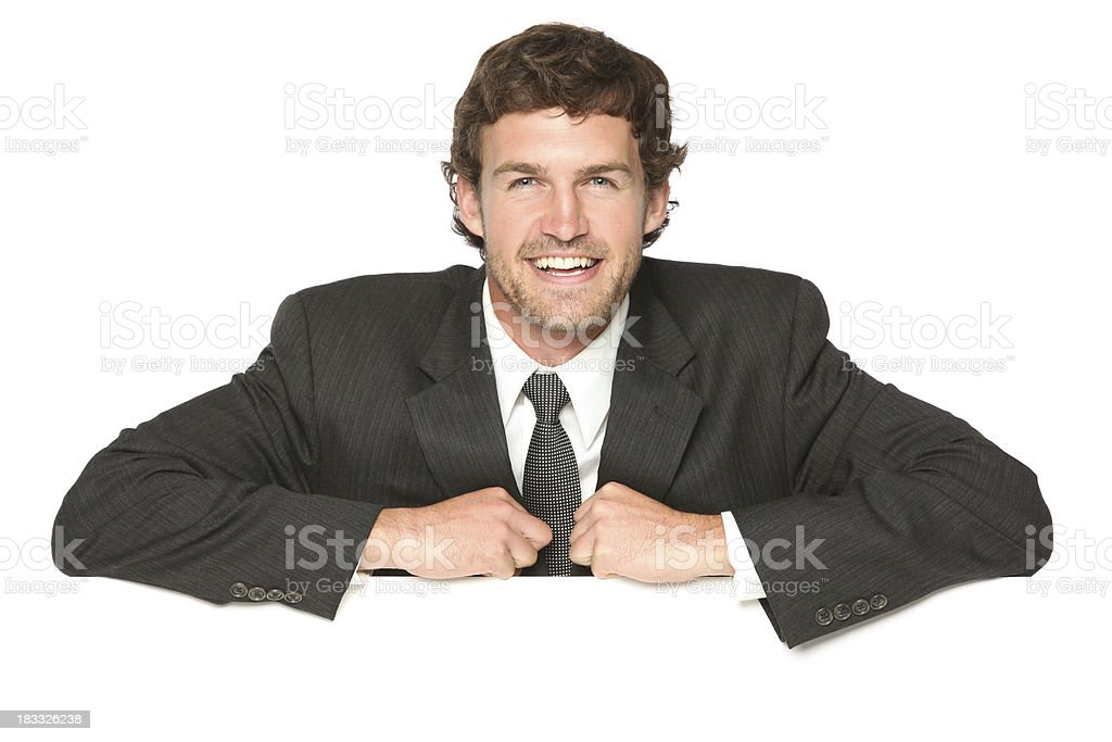 Confident businessman behind a placard royalty-free stock photo