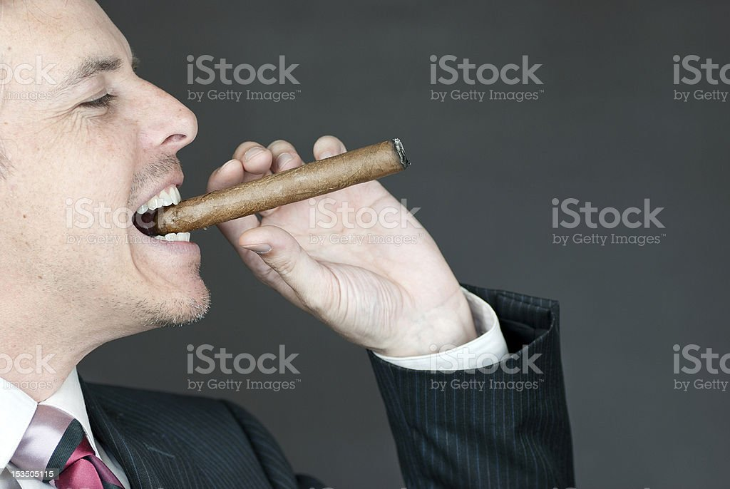 Confident Businessman Celebrates With Cigar royalty-free stock photo