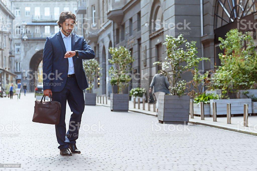 Confident businessman has meeting soon stock photo