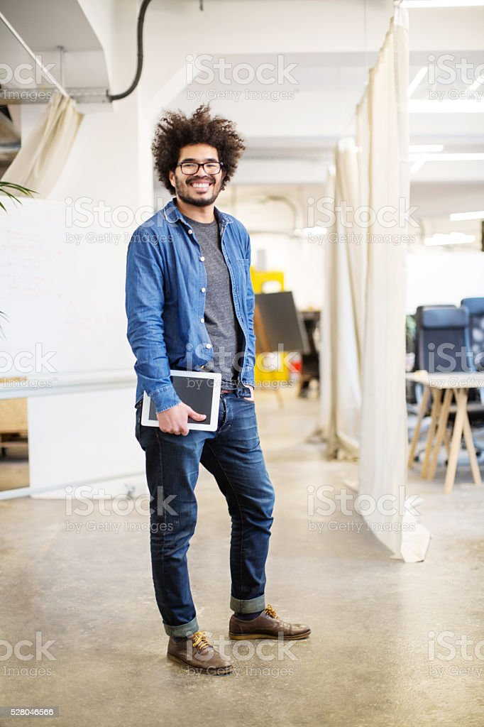 Confident businessman holding digital tablet stock photo