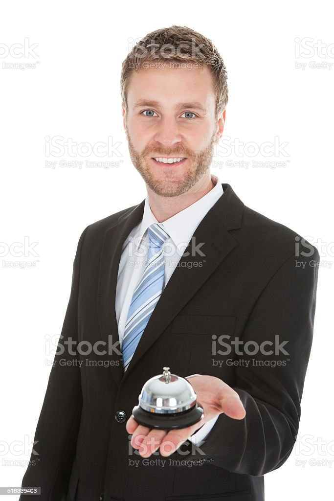 Confident Businessman Holding Service Bell stock photo