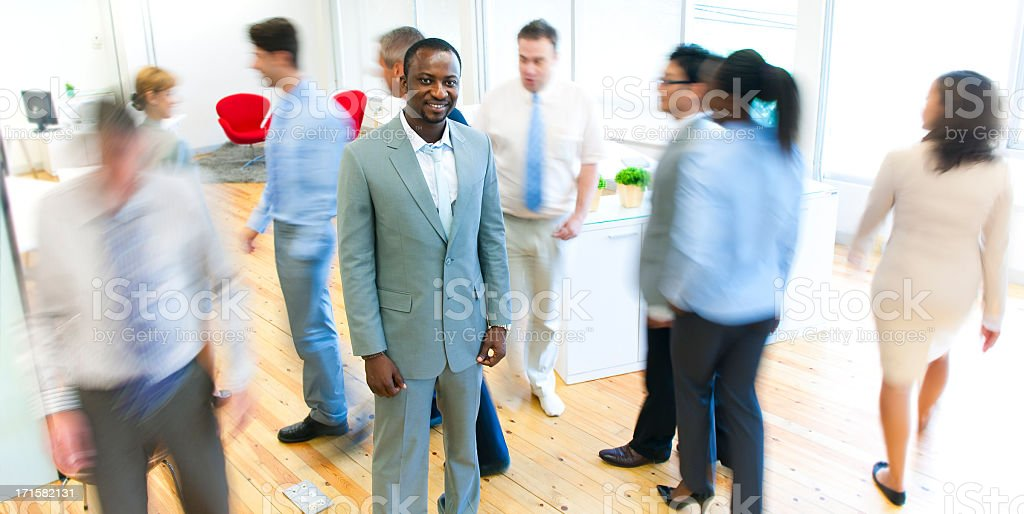 Confident Businessman in a busy office. royalty-free stock photo