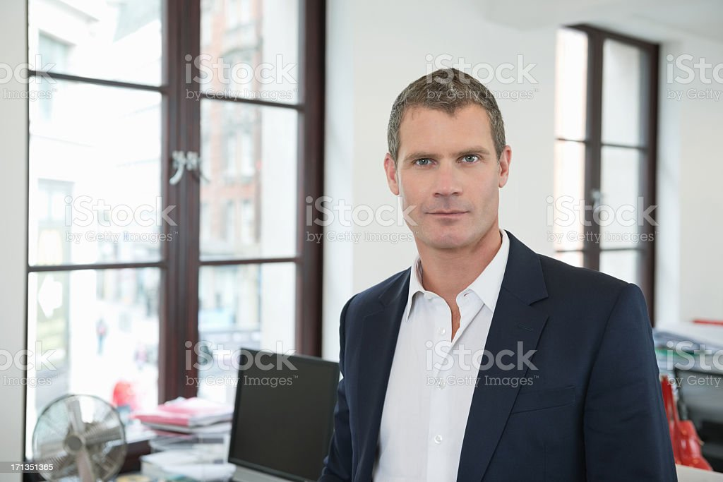 Confident Businessman In Office stock photo