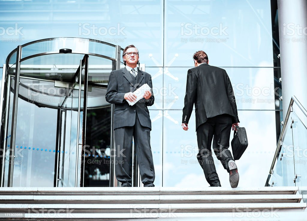 Confident businessman outside the office building. stock photo