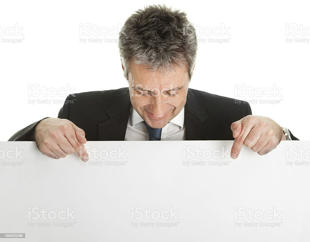 Confident businessman pointing to an empty board stock photo