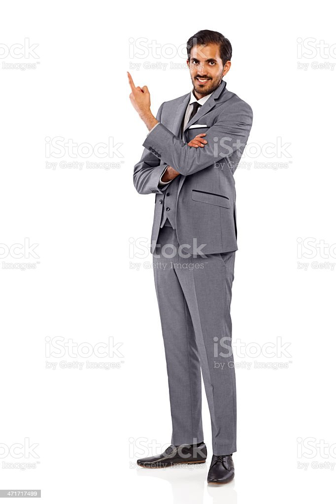 Confident businessman showing empty space for your advertisement royalty-free stock photo