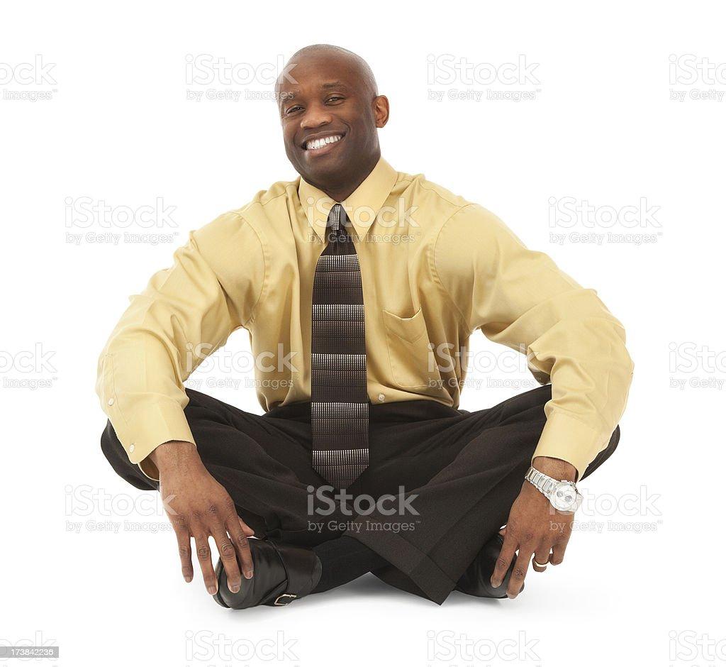 Confident Businessman Sitting Cross-legged on Floor stock photo