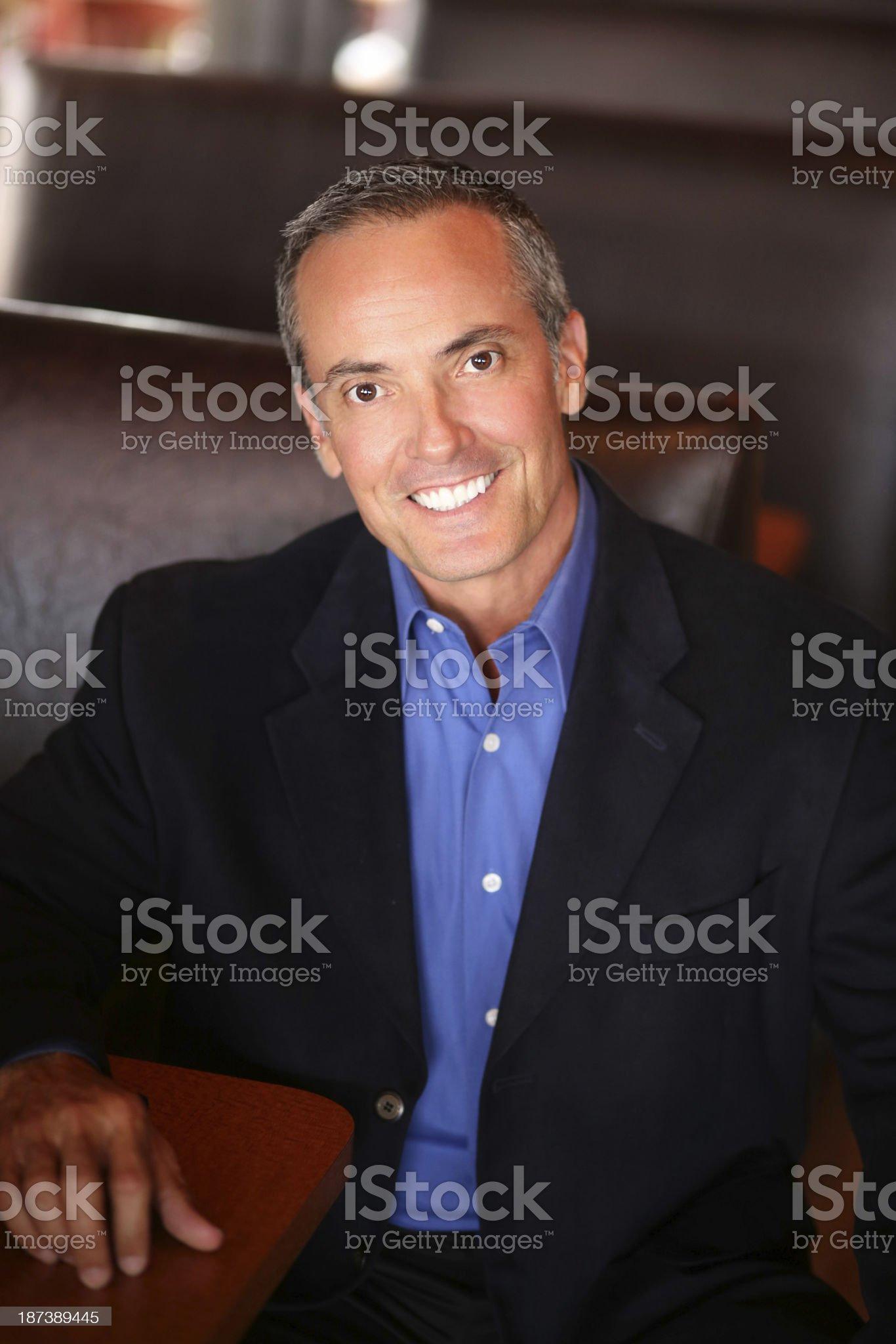 Confident Businessman Sitting In Restaurant royalty-free stock photo