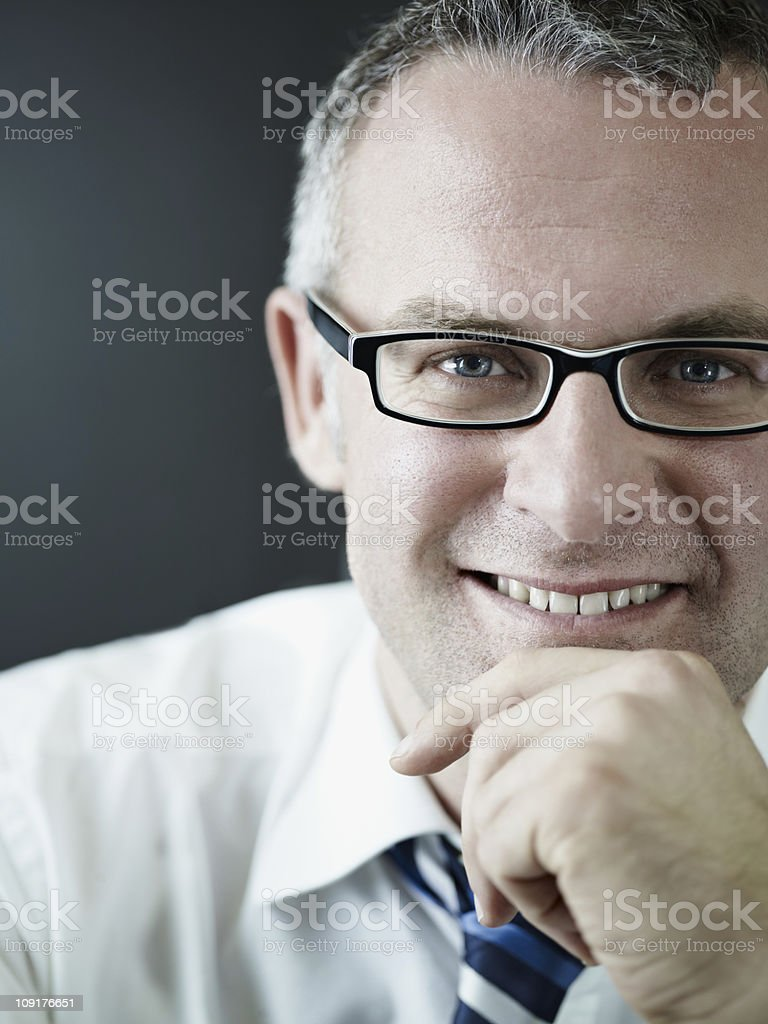 confident businessman smiling at camera royalty-free stock photo