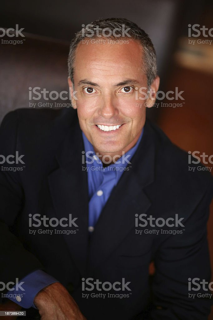 Confident Businessman Smiling In Restaurant royalty-free stock photo