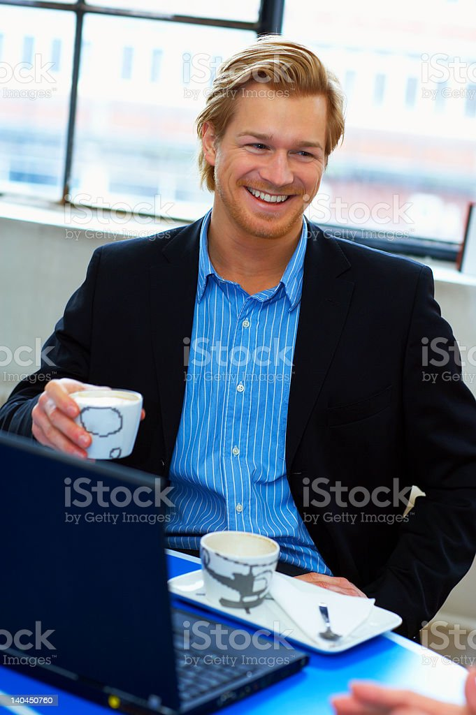 Confident businessman smiling royalty-free stock photo