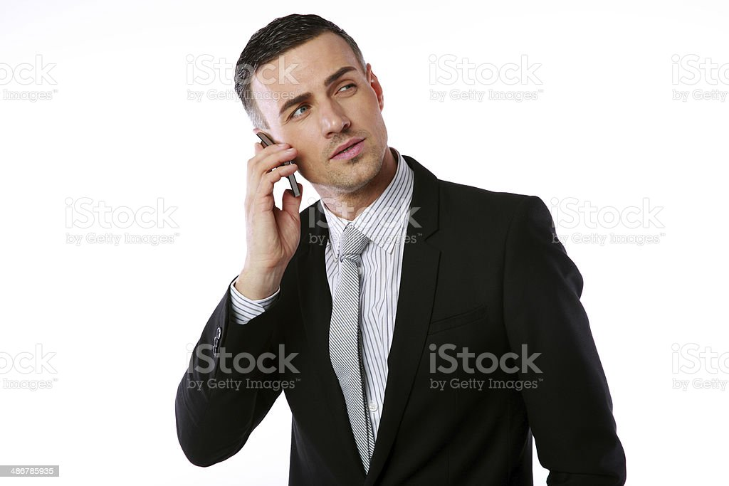 Confident businessman talking on the phone stock photo