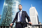 Confident Businessman with bicycle