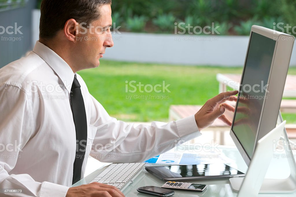 Confident businessman working at a computer royalty-free stock photo