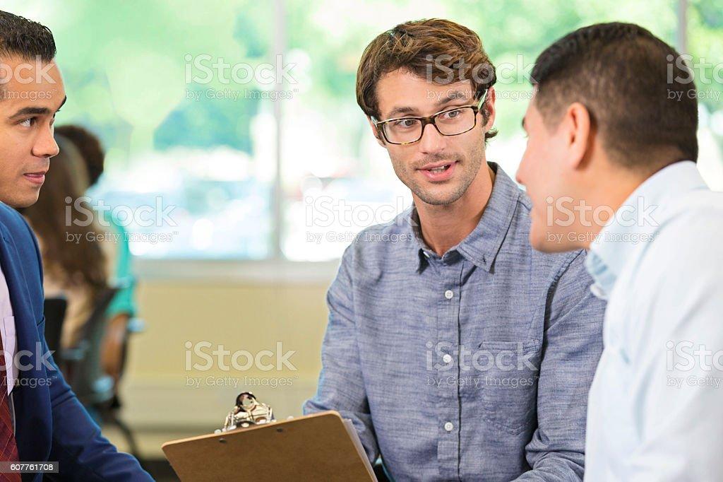 Confident businessmen brainstorm during conference stock photo