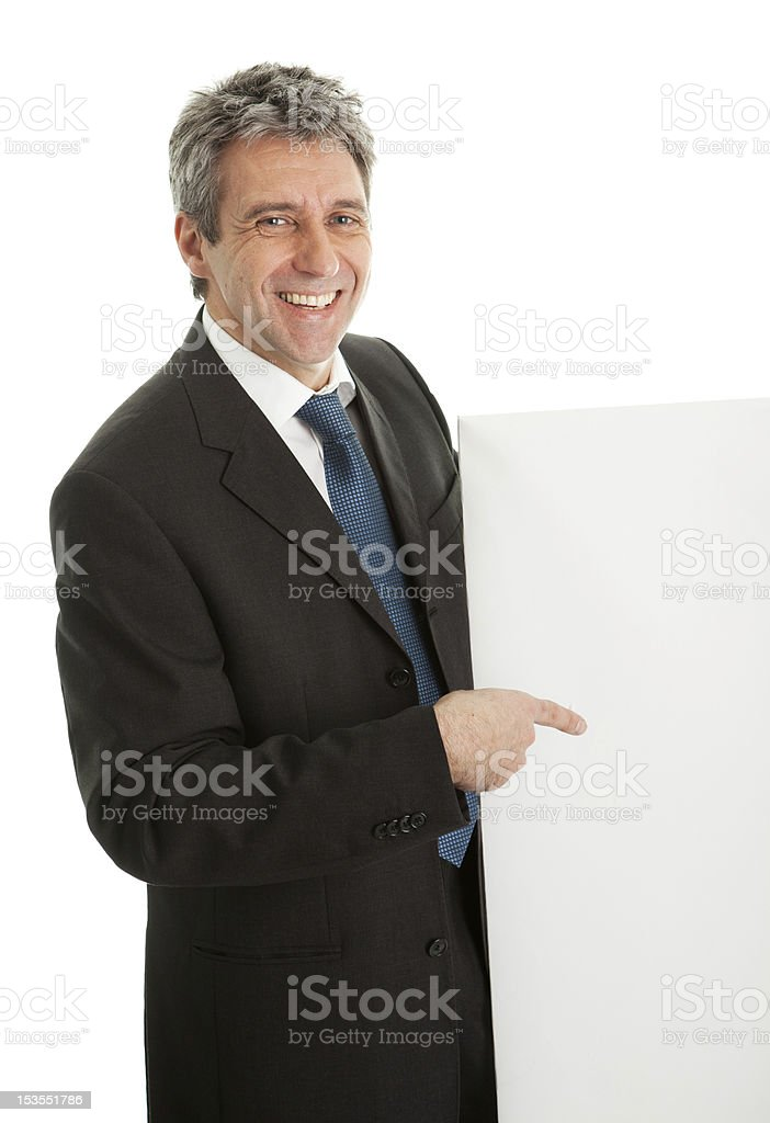 Confident businessmen presenting empty board royalty-free stock photo
