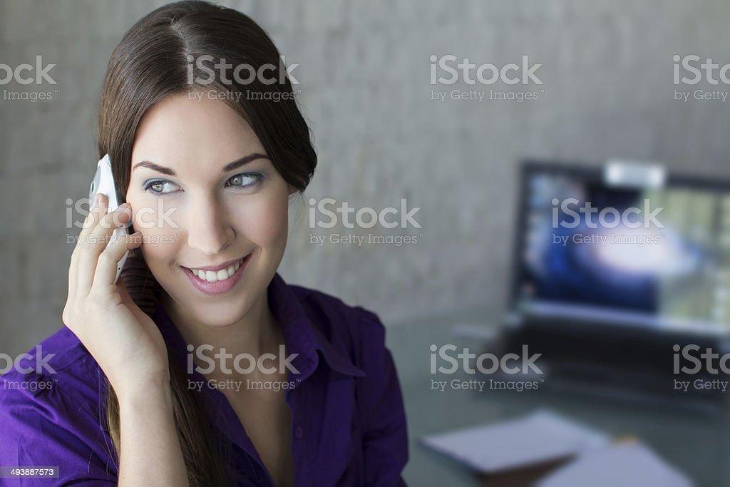 Confident businesswoman calling royalty-free stock photo